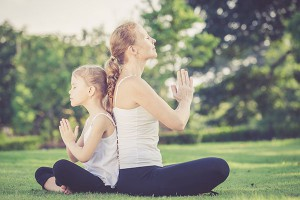 kids yoga classes in Wembley, Western Australia. Mother and daughter practising yoga outdoors