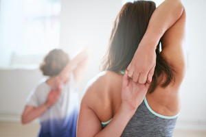 yoga classes in wembley. Two woman in yoga class